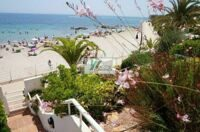Townhouse in first line beach with lovely sea views.