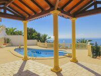 Villa with panoramic views of the sea and the Peñón de Ifach is located on the first line of the sea on the coast of Benissa