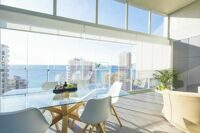 Penthouse with views to the sea and the Peñón de Ifach, one step away from the sandy beach in Calpe